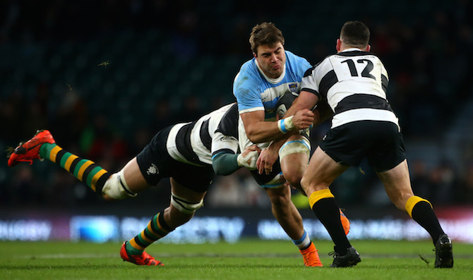 Ryan Crotty (right) attempts to stop Argentina's Facundo Isa